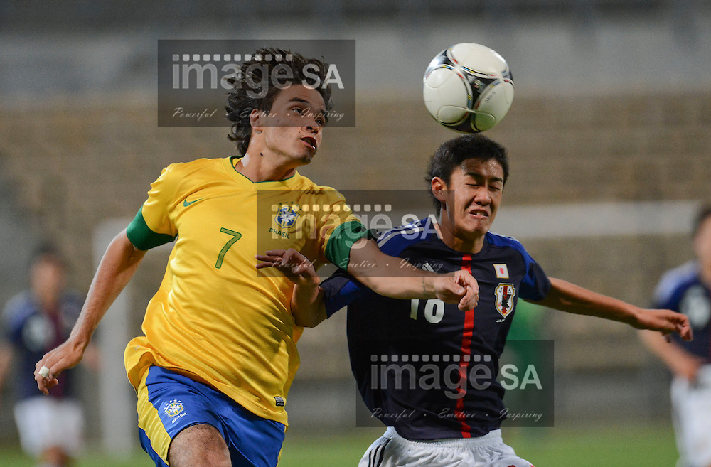CAPE TOWN, SOUTH AFRICA: Wednesday 30 May 2012, MISAEL BUENO of Brasil is challenged by HIROKI AKINO of Japan during the under 20 Cape Town International Soccer Challenge between Brazil and Japan at the Athlone Stadium..Photo by Roger Sedres/ImageSA