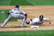 Seattle Mariners shortstop, Brad Miller reaches for first base to beat the ball for a tag out during a match up against the Minnesota Twins. Photo by John Lill
