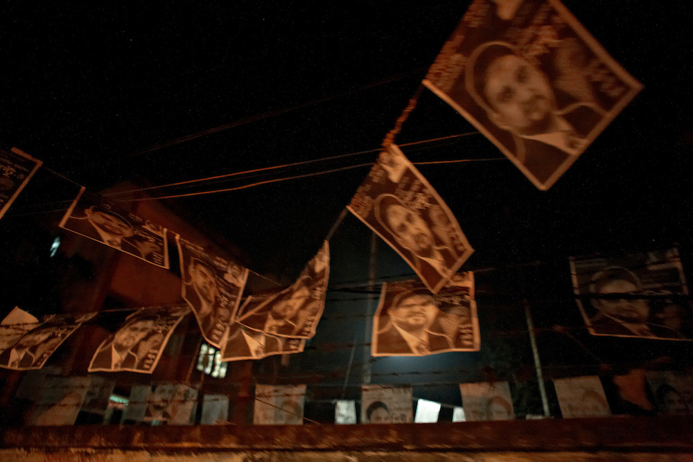 Election posters, Hazaribag, Dhaka, Bangladesh. ..The skies of the city is covered by election posters on December 27, 2008. As it is illegal to put them on walls, the posters are hung between buildings..Last night of campaigning is calm in the city while awaiting election day of the 29th...Bangladesh has finished with two years of emergency rule. The election results is compared to the landslide of 1970 that led to war and independence from Pakistan. .When preparations for the election started in late 2006, violent street-protests started, and led to a military backed interim government until the election happened under heavy security and watchful eyes on December 29th 2008...The past two years have seen a decrease of crime and corruption but also sparked violent student protests and curfews. Today  most people seem to be happy to return to some sort of normality. But in one of the poorest countries in the world where 80% live for less than a dollar a day, does it really matter who is in power? The circus is over, back to reality and putting food on the table...A blogger  from dhaka is quoted Ó we prefer messy democracy to military ruleÓ...Is this the end of night, a new dawn or yet another dusk?..Photo by: Eivind H. Natvig/MOMENT *** Local Caption ***