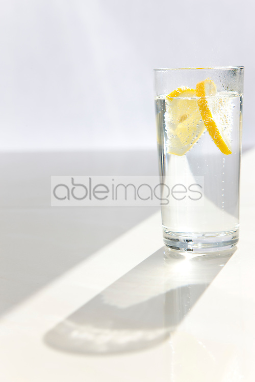 Glass of sparkling water with sliced lemon