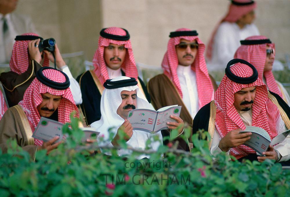 Men watching horse racing at Riyadh Races, Saudi Arabia.