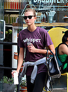 July 30, 2014 - New York City, NY, United States - <br /> <br /> American fashion model Karlie Kloss in Soho<br /> <br /> Model Karlie Kloss walks in Soho on July 30 2014 in New York City  <br /> American fashion model. Kloss is ranked seventh on the Top 50 Models Women list by Models.com. Vogue Paris declared her one of the top 30 models of the 2000s., She is a Victoria's Secret Angel.<br /> ©Exclusivepix