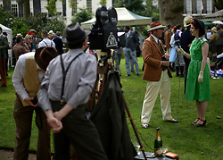 © Licensed to London News Pictures. 07/07/2012. London, UK  A 'vintage' film crew record an interview at 'The Chap's Olympiad' in central London on July 7th, 2012. 'The Chap' is a light-hearted magazine, aimed at revisiting the fashions and pastimes of the polite aspects of 1920's to 1950's England. The annual Olympiad event sees competitors take part in events such the 'Cucumber Sandwich Discus', 'The Umbrella Joust' and 'The Tug of Hair'e. Photo credit : Stephen Simpson/LNP