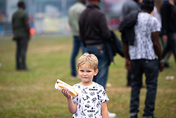 © Licensed to London News Pictures . 12/08/2018. Manchester , UK . ANDREW BLAKEY (five, from Blackpool). The second day of the annual Caribbean Carnival in Alexandra Park in Moss Side , celebrating music , food and Afro-Caribbean culture . A nearby shooting overnight lead to at least ten people injured . Ten people are in hospital . Photo credit : Joel Goodman/LNP