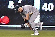 April 13, 2017 - Kansas City, MO, USA - Oakland Athletics right fielder Mark Canha drops a line drive for a single bythe  Kansas City Royals' Eric Hosmer in the fifth inning at Kauffman Stadium in Kansas City, Mo., on Thursday, April 13, 2017. (Credit Image: © John Sleezer/TNS via ZUMA Wire)