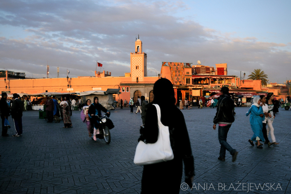 Morocco, Marrakesh. People in Djemaa el Fna Square at sunset.
