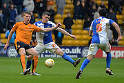 Blackburn Rovers midfielder Darragh Lenihan attempts to block Wolverhampton Wanderers striker Bjorn Sigurdarson's pass during the Sky Bet Championship match between Wolverhampton Wanderers and Blackburn Rovers at Molineux, Wolverhampton, England on 9 April 2016. Photo by Alan Franklin.