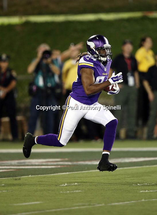 Minnesota Vikings kick returner Cordarrelle Patterson (84) returns a kick during the 2015 NFL Pro Football Hall of Fame preseason football game against the Pittsburgh Steelers on Sunday, Aug. 9, 2015 in Canton, Ohio. The Vikings won the game 14-3. (©Paul Anthony Spinelli)