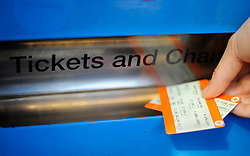 Embargoed to 2230 Wednesday May 31 File photo dated 11/01/16 of a person buying a train ticket. Labour has pledged to save rail commuters more than £1,000 on their season tickets over the next five years and cap fares for other passengers.