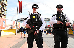 """Police presence outside the stadium before the Emirates FA Cup Final at Wembley Stadium, London. PRESS ASSOCIATION Photo. Picture date: Saturday May 27, 2017. See PA story SOCCER Final. Photo credit should read: Adam Davy/PA Wire. RESTRICTIONS: EDITORIAL USE ONLY No use with unauthorised audio, video, data, fixture lists, club/league logos or """"live"""" services. Online in-match use limited to 75 images, no video emulation. No use in betting, games or single club/league/player publications."""