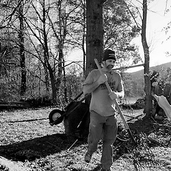 Kyle Green | The Roanoke Times<br /> 1/24/2012 Paul Davis walks with a pitchfork to turn a compost pile outside of his home in New Castle, Virginia. The family uses various means to get by in a tough economy, including growing their own herbs and vegetables, keeping chicken for eggs, and bartering goods for their artwork and services.
