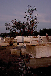 03 November, 2005. New Orleans, Louisiana. Post Katrina.<br />  Merrick Cemetery, St Bernard Parish just outside New Orleans, Louisiana in the aftermath of Hurricane Katrina. FEMA contractors are still removing coffins from the graveyard destroyed by the storm. Merrick cemetery was one of the earliest slave cemeteries in the south and was deluged by 20ft of flood water.<br /> Photo; ©Charlie Varley/varleypix.com