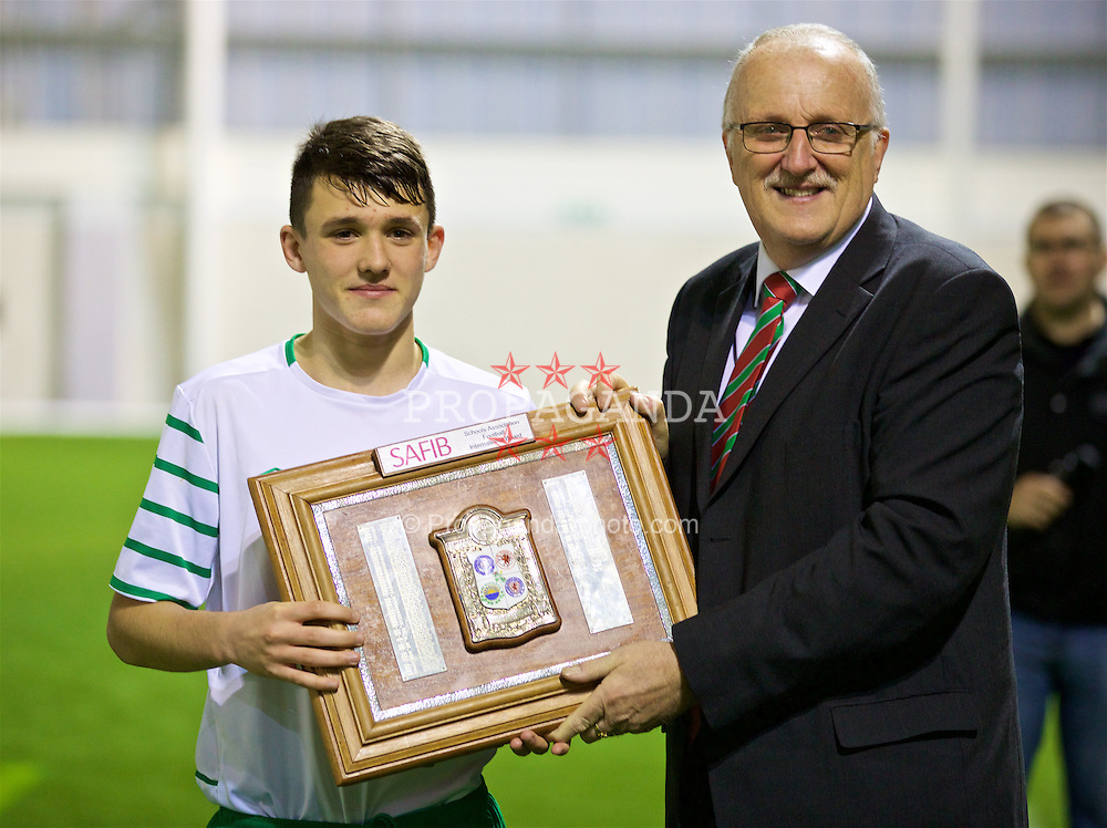 EDINBURGH, SCOTLAND - Friday, November 4, 2016: Wales' Cledwyn Ashford presents Republic of Ireland's captain Jason Knight with the trophy as he celebrates winning the Under-16 2016 Victory Shield at ORIAM. (Pic by David Rawcliffe/Propaganda)