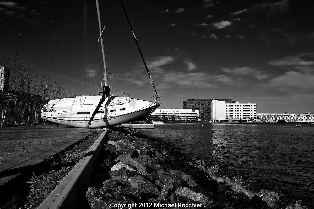 HOBOKEN, NJ - November 21:  A sailboat remains grounded on a sidewalk next to the pier after being washed ashore from Hurricane Sandy on November 21, 2012 in Hoboken, New Jersey.  (Photo by Michael Bocchieri/Bocchieri Archive)