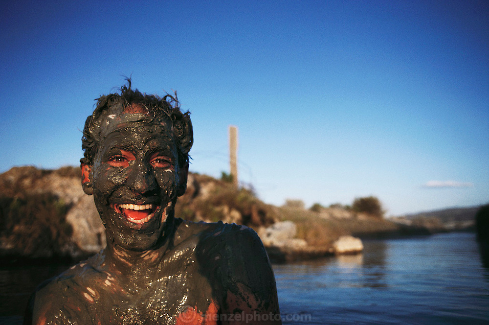 Miguel Fairbanks mud bathing at a natural hot springs near Gerlach, Nevada. MODEL RELEASED.