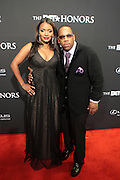 8 February -Washington, D.C: (L-R) Teasha Bivens and Recording Artist Michael Bivens attend the BET Honors 2014 Red Carpet held at the Warner Theater on February 8, 2014 in Washington, D.C.  (Terrence Jennings)
