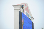 A man works on the scoreboard at Vaught-Hemingway Stadium in Oxford, Miss. on July 31, 2014.