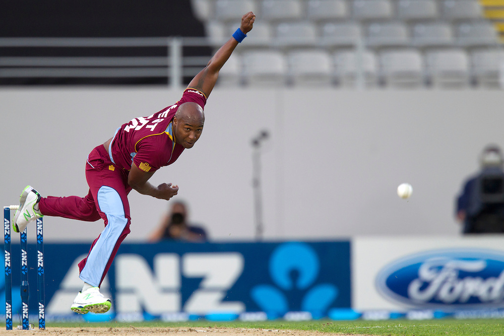 West Indies' Tino Best bowls against New Zealand  in the Twenty-20 International Cricket Match, Eden Park, Auckland, New Zealand, Saturday, January 11, 2014. Credit: SNPA/David Rowland