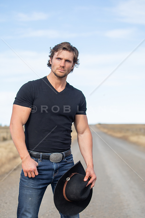 All American cowboy on a dirt road
