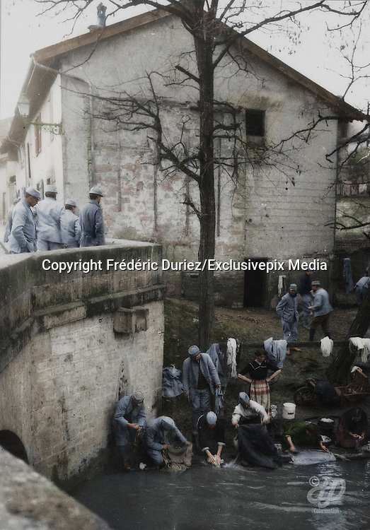 """Colorized photographs soldiers from the World War One<br /> <br /> With his impressive colorized photographs of the World War One, Frédéric Duriez gives us a new look at the conflict that ravaged the world between 1914 and 1918, revealing the difficult daily life of the French soldiers. <br /> <br /> Photo Shows: """"Sainte Menehould - On January 12, 1916 .<br /> Road of Vitry, Soldiers and """"""""Lavandières"""""""" at the laundry .<br /> ©Frédéric Duriez/Exclusivepix Media"""