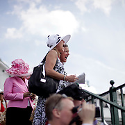 Denise Meroni, left, and her friend of 50 years Marlitt Dellabough cheer for their horse they bet on in the 10th race at the 138th running of the Kentucky Derby at Churchill Downs in Louisville, Ky. Saturday May 5, 2012. The friends are from Eugene, Oregon. Photo by David Stephenson