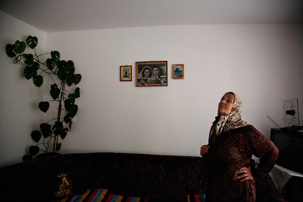 Sija Mustafic in her home in Srebrenica, with a portrait of her and her late husband Mehmedalija who was killed in July 1995...Matt Lutton for The International Herald Tribune..Capture of Ratko Mladic. Srebrenica, Bosnia and Herzegovina. May 29, 2011.