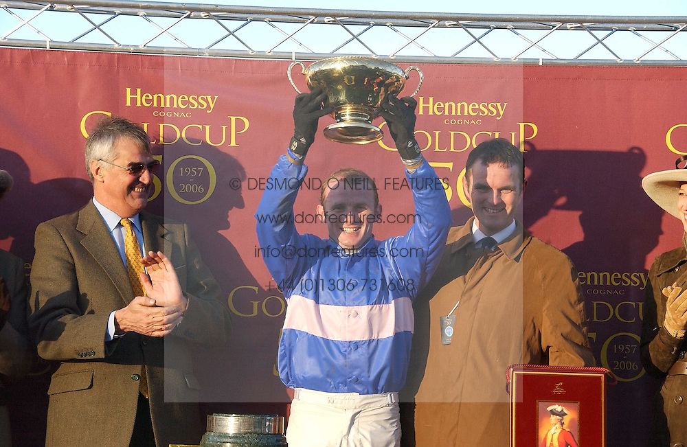 Left to right, MAURICE HENNESSY , jockey of State of Play winner of the 2006 Hennessy Gold Cup PAUL MOLONEY and trainer EVAN WILLIAMS at the 50th running of the Hennessy Gold Cup at Newbury Racecourse, Berkshire on 25th November 2006.<br /><br />NON EXCLUSIVE - WORLD RIGHTS