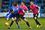 Gillingham forward Joe Quigley (17) pressured off the ball by Southend United defender Ryan Leonard (18) during the EFL Sky Bet League 1 match between Gillingham and Southend United at the MEMS Priestfield Stadium, Gillingham, England on 25 February 2017. Photo by Martin Cole.