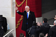 Vice President elect Mike Pence waves as he walks from the U.S. Capitol at the start of the 68th Inaugural ceremony January 20, 2017 in Washington, DC. Donald Trump became the 45th President  of the United States of America.