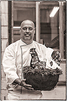 Preparation des chocolats de Paques chez Philippe Bernachon, petit fils de Paul Bocuse et l'un meilleurs chocolatiers du monde.<br /> Sur la photo, Philippe tient une poule de 4 kg<br /> <br /> Preparation of chocolates of Easter inside Philippe Bernachon's chocolate factory, grandson of Paul Bocuse and one of better chocolate makers of the world.<br /> Philippe and a hen weighing 4 kg