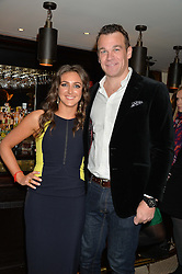 NATASHA CORRETT and her fiance SIMON BATEMAN at a party to celebrate the publication of Honestly Healthy Cleanse by Natasha Corrett held at Tredwell's Restaurant, 4a Upper St.Martin's Lane, London on 14th January 2015.