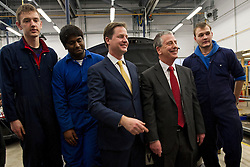 © London News Pictures. 11/02/2013 . Eastleigh, UK.  Leader of the Liberal Democrat Party, NICK CLEGG (third left) with the Liberal Democrat part candidate for the Eastleigh by-election MIKE THORNTON (second right) speaking to automotive studies students during a visit to Eastleigh College in Eastleigh, Hampshire on February 11, 2013. The by-election was called when the former MP for Eastleigh, Chris Hune, resigned after admitting perverting the course of justice. Photo credit : Ben Cawthra/LNP