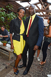 OZWALD BOATENG and KIARA KABUKURU attending the Warner Bros. & Esquire Summer Party held at Shoreditch House, Ebor Street, London E1 on 18th July 2013.