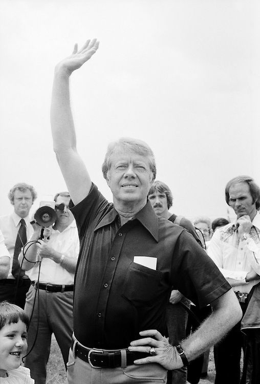 Jimmy Carter waves goodbye to John Glenn at the Plains, Georgia airport after interviewing him as a possible vice presidential running mate. - To license this image, click on the shopping cart below -
