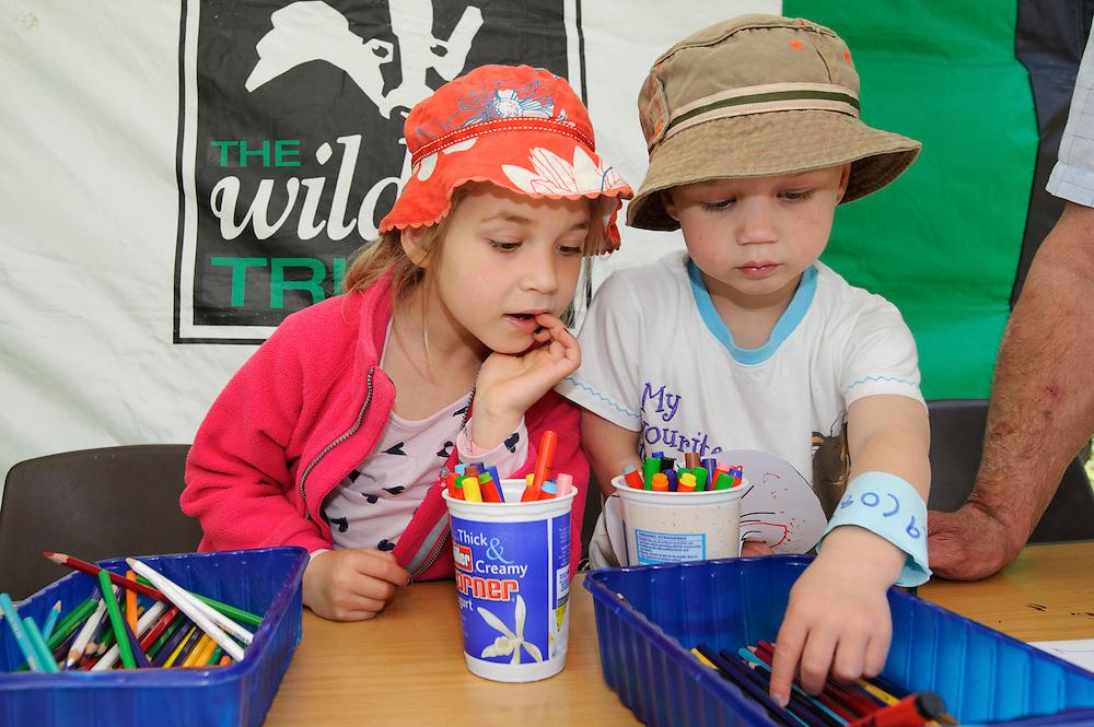 Sophie and Oliver making osprey masks at Lyndon Visitor Centre, Rutland Water