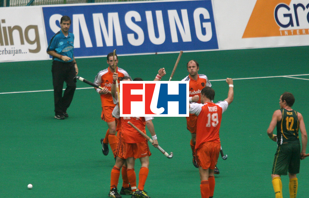 Kuala Lumpur :  Taeke Taekama of Netherlands celebrates his second goal against Australia in the Samsung Hockey Men Champions Trophy at the National Stadium, Bukit Jalil, Malaysia on 06 Dec 2007. This incident was refered to Video Umpire. Australia drew with Netherlands 3-3.<br /> This match is the 500th match in the history of the Champion trophy.<br /> Photo:GNN/Vino John