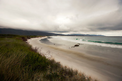Rainclouds build over Dennison Beach at Long Point on the east coast of Tasmania.