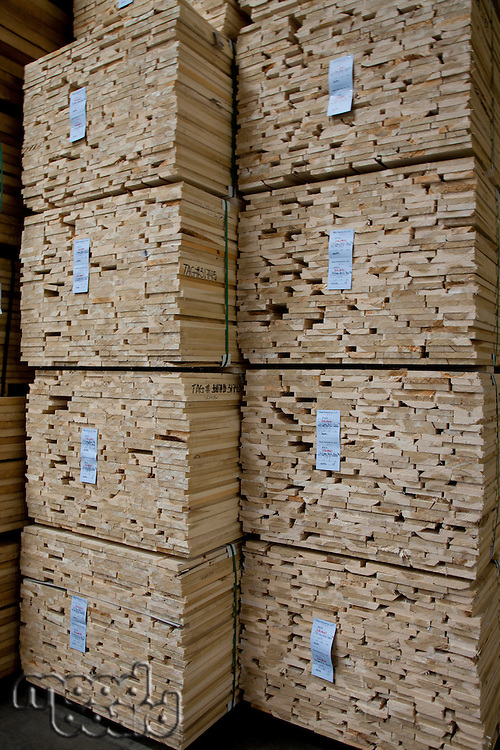 Close-up of stacks of plywood in warehouse
