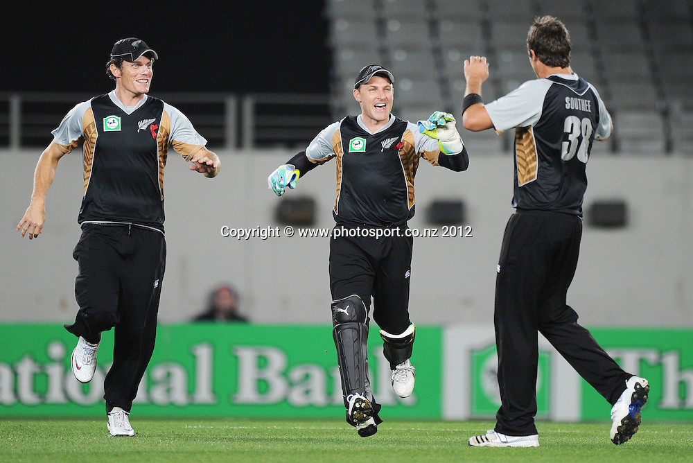Rob Nicol and Brendon McCullum celebrate with Tim Southee after the dismissal of Johan Botha during the 3rd and final InternationaI Twenty20 cricket match between New Zealand Black Caps and South Africa at Seddon Park, Hamilton, New Zealand on Wednesday 22 February 2012. Photo: Andrew Cornaga/Photosport.co.nz