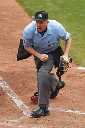 August 7, 2011; San Francisco, CA, USA;  MLB umpire Mike Everitt (57) calls out San Francisco Giants first baseman Aubrey Huff (not pictured) after a tag by Philadelphia Phillies catcher Carlos Ruiz (not pictured) at home plate during the fourth inning at AT&T Park. San Francisco defeated Philadelphia 3-1.