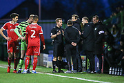 Referee speaks to managers during the EFL Sky Bet League 2 match between Forest Green Rovers and Scunthorpe United at the New Lawn, Forest Green, United Kingdom on 7 December 2019.