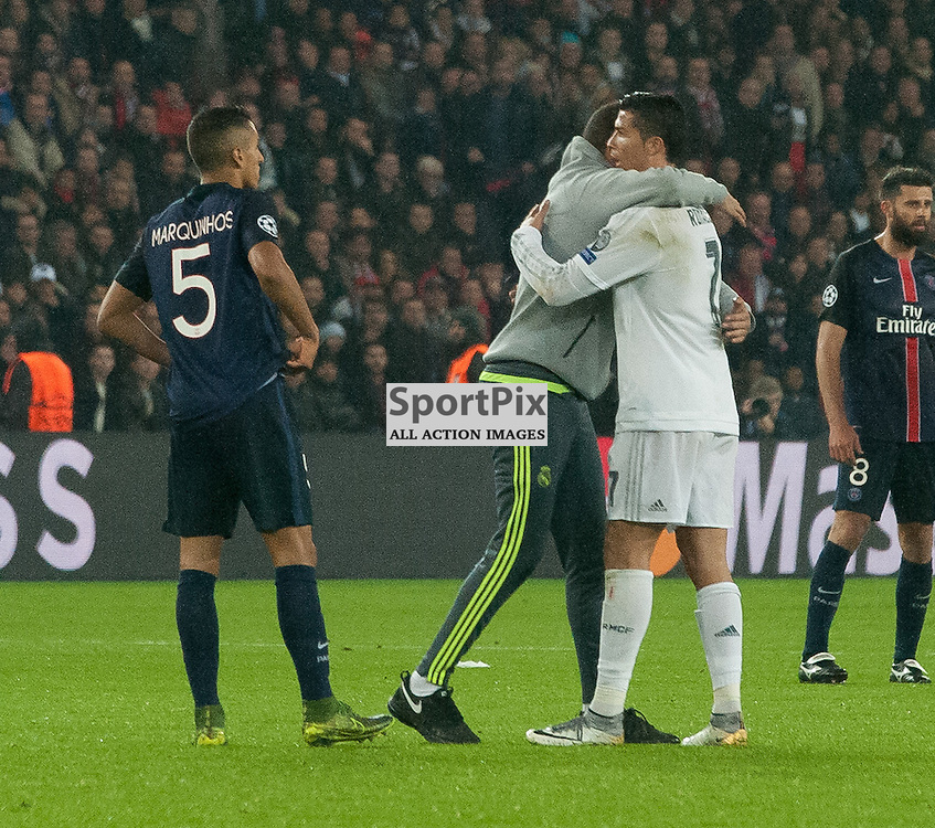 A pitch invader embraces Cristiano Ronaldo (Real Madrid)