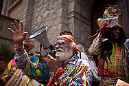 """El Diablo Mayor, Roberto """"Robin"""" Izaguirre, durante la festividad del Corpus Christi, representada en Venezuela a traves del ritual magico-religioso de los Diablos Danzantes. Los Diablos de Naiguata se identifican por pintar sus propios trajes y decorarlos con cruces, rayas y circulos, figuras que impiden que el maligno los domine. Las mascaras son en su gran mayoria animales marinos. Llevan escapularios cruzados, crucifijos y cruces de palma bendita. Naiguata, 23 Junio 2011 (ivan gonzalez)"""