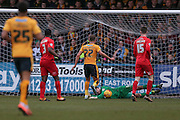 Cambridge United forward Ben Williamson  picks the ball off York City goalkeeper Scott Flinders  to score Cambridge United third goal during the Sky Bet League 2 match between Cambridge United and York City at the R Costings Abbey Stadium, Cambridge, England on 20 February 2016. Photo by Simon Davies.