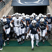 Head coach Bill O'Brien and the Penn State players run through the tunnel and onto the field before the start of the annual Blue/White game on April 20, 2013 at Beaver Stadium in University Park, PA.