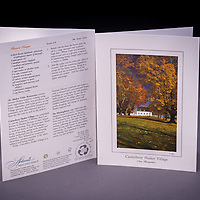 A row of old sugar maples in gorgeous fall colors of gold and yellow welcome visitors to the Canterbury Shaker Village meetinghouse.  Back of the card includes a recipe for Harvest Bisque and interesting historical anecdotes. Also available as a Limited Edition Fine Art Print. <br />