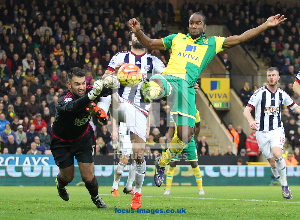 Cameron Jerome of Norwich and Boaz Myhill of West Bromwich Albion in action during the Barclays Premier League match at Carrow Road, Norwich<br /> Picture by Paul Chesterton/Focus Images Ltd +44 7904 640267<br /> 24/10/2015