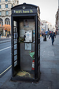Vomit in a black phone box filled with flowers on The Strand, Central London, United Kingdom. Only telephone boxes owned by BT (British Telecom) can be the iconic red colour, hence this one being black.  (photo by Andrew Aitchison / In pictures via Getty Images)