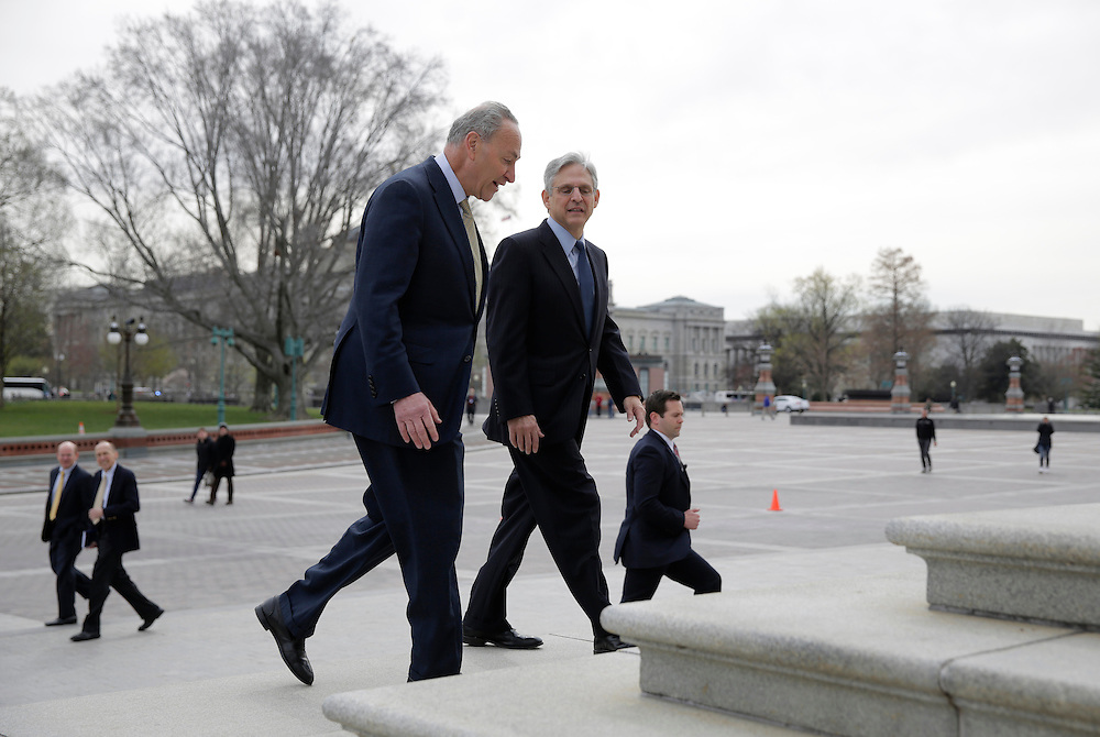 Senator Charles Schumer (D-NY)(L) walks with Judge Merrick Garland, President Obama's Supreme Court nominee, on Capitol Hill in Washington March 22, 2016.      REUTERS/Joshua Roberts
