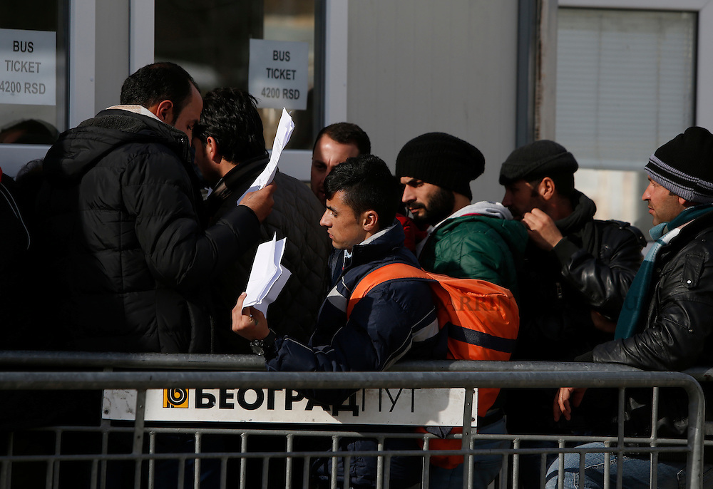 Migrants and refugees queue to buy bus tickets to continue their journey towards western Europe from the Macedonia-Serbia border at a transit camp in the village of Presevo, Serbia, February 2, 2016.<br /> Photo: Darrin Zammit Lupi